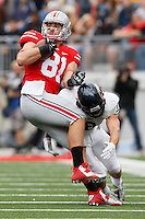 Ohio State Buckeyes tight end Nick Vannett (81) is upended by Kent State Golden Flashes safety Nate Holley (18) during Saturday's NCAA Division I football game at Ohio Stadium in Columbus on September 13, 2014. (Dispatch Photo by Barbara J. Perenic)