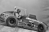 Steve Chassey slides through a turn during a 1976 USAC sprint car race at Eldora Speedway near Rossburg, Ohio.