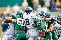 October 2, 2010:   San Diego Toreros running back Phil Morelli (8) is swarmed under by a host of Jacksonville Dolphins defenders during Pioneer Football League action between the San Diego Toreros and Jacksonville University Dolphins at D. B. Milne Field in Jacksonville, Florida.  Jacksonville defeated San Diego 35-28.