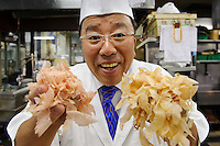 "Tamura Takashi, owner of ""Tsukiji Tamura"" Japanese restaurant, holding two kinds of katsuobushi, Tokyo, Japan, July 17, 2009. Tsukiji Tamura is one of the best known ""ryotei"" traditional Japanese restaurants in Tokyo. Owner Tamura prepares dashi using two types of katsuobushi plus kombu from Hakodate in Hokkaido."