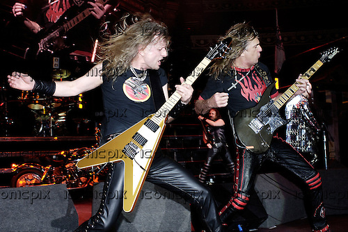 Judas Priest - guitarists KK Downing and Glenn Tipton - performing live in concert at the benefit for the Teenage Cancer Trust held at the Royal Albert Hall in London UK - 31 March 2006.  Photo credit: George Chin/IconicPix