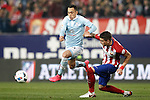 Atletico de Madrid's Jose Maria Gimenez (r) and Celta de Vigo's Fabian Orellana during Spanish Kings Cup match. January 27,2016. (ALTERPHOTOS/Acero)