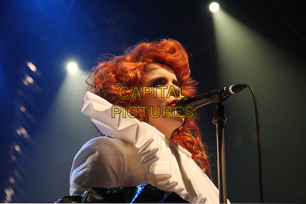 PALOMA FAITH.Performs Live in concert, Koko Camden, London, England, UK, .23rd November 2009..music gig on stage portrait headshot white ruffle collar microphone singing profile .CAP/MAR.© Martin Harris/Capital Pictures.