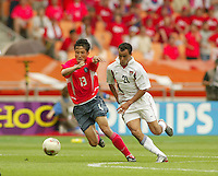 Landon Donovan races for the ball. The USA tied South Korea, 1-1, during the FIFA World Cup 2002 in Daegu, Korea.