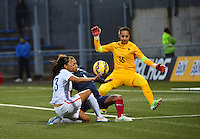 Lorient, France. - Sunday, February 8, 2015: Christen Press of the USWNT vs Laura Georges (4) and goalkeeper Sarah Bouhaddi (16) of France. USWNT vs France during an international friendly at the Stade du Moustoir.