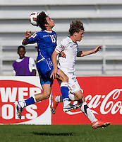 Andrew Olivier (16) of the United States goes up for the ball with Olivier Ayala (15) of El Salvador during the quarterfinals of the CONCACAF Men's Under 17 Championship at Catherine Hall Stadium in Montego Bay, Jamaica. The USA defeated El Salvador, 3-2, in overtime.