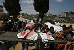 Palestinians carry the bodies of Palestinian children from the al-Najar family, who medics said were killed by an Israeli air strike on their house, during their funeral in Khan Younis in the southern Gaza Strip July 26, 2014. The Gaza Health Ministry said 18 members of a single family were killed by Israeli tank shelling in the southern Gaza Strip shortly before the truce took effect at 8 a.m. (6 a.m. British Time). An Israeli military spokeswoman said she was checking the report. A 12-hour humanitarian truce went into effect on Saturday after Israel and Palestinian militant groups in the Gaza Strip agreed to a U.N. request for a pause in fighting and efforts proceeded to secure a long-term ceasefire moved ahead. Photo by Eyad Al Baba