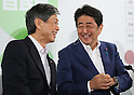 July 10, 2016, Tokyo, Japan - Japanese Prime Minister and ruling Liberal Democratic Party (LDP) president Shinzo Abe smiles with LDP vice president Masahiko Komura for the result of the Upper House election at the LDP headquarters in Tokyo on Sunday, July 10, 2016.    (Photo by Yoshio Tsunoda/AFLO) LWX -ytd-