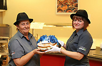 Pictured L-R: Lotto winners colleagues Clare Birchall and Andrea Davies holding a cake for them at Neath Port Talbot hospital. Wednesday 08 November 2017<br />