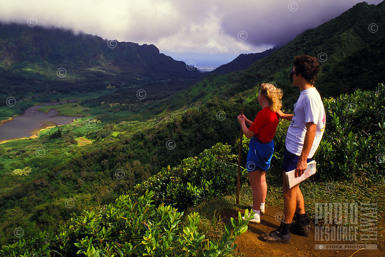 Couple overlooking Nuuanu valley with the Pali lookout at the end of the valley