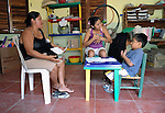Elizabet Ramirez Avendaño (center) teaches sign language to Felipe de Jesus Piña Alonso, a 6-year old deaf boy, during a class at Piña Palmera, a center for community based rehabilitation for people living with disabilities in Zipolite, a town in Oaxaca, Mexico. On the left is the boy's mother, Teofila Alonso Martinez.