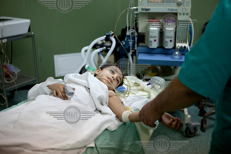 Weam Al Astal, a nine year old from Khan Younes, prepares to undergo surgery after she received serious injuries during the summer 2014 Israeli military operation ('Pillar of Defense') in the Gaza Strip. The Israeli operation lasted 51 days and resulted in 2,145 deaths and 11,231 injuries among the Palestinian population. The vast majority of the serious casualties have complex orthopaedic injuries that the Palestinian Ministry of Health is ill-equiped to manage. DFID/UK Aid is funding NHS Doctors, deployed through the UK's Rapid Response Facility's funding, to work alongside Medical Aid for Palestinians (MAP) in providing post conflict surgery at Gaza's Shifa Hospital. The NHS doctors (through the charity Ideals) volunteer to visit Gaza in their spare time and work alongside their Palestinian colleagues. <br /> <br /> Weam's mother says: 'She was sitting with her father and playing with her other cousins in the garden of their small home when a rocket hit them directly. She lost one leg. Four of her cousin's, all girls, were injured too, and her father he also lost a leg. Weam's injury is the worst. They were targeting children, they could see that there were children playing there.'