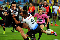 New Zealand's Jordan Rapana is tackled by Fiji's Marcelo Montoya during the 2017 Rugby League World Cup quarterfinal match between New Zealand Kiwis and Fiji Bati at Wellington Regional Stadium in Wellington, New Zealand on Saturday, 18 November 2017. Photo: Dave Lintott / lintottphoto.co.nz