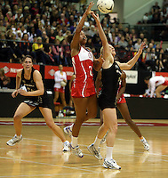 25.10.2012 Silver Ferns Laura Langman and England's Serena Guthrie in action during the Silver Ferns v England netball test match as part of the Quad Series played at the TSB Arena Wellington. Mandatory Photo Credit ©Michael Bradley.