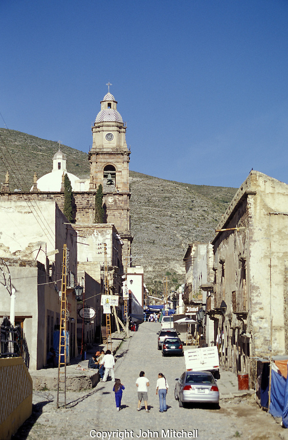 Calle Lanzagorta, the main street of the 19th-century silver-mining town of Real de Catorce, San Luis Potosi state, Mexico. Real de Catorce became a virtual ghost town during the early part of the 20th century. It has recently become a popuar destination for travellers.