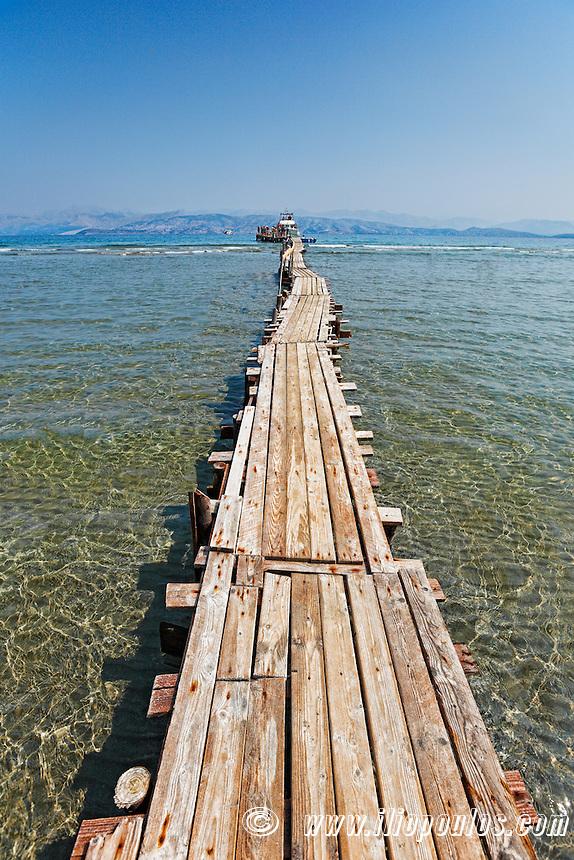 A long platform over the shallow water of Kalamaki at Corfu, Greece