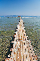 A long platform over the shallow water of Kalamaki at Corfu, Greece