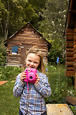 USA, Alaska, Redoubt Bay, Big River Lake, a young girl showing off her camera at Redoubt Bay Lodge