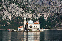 Our Lady of the Rocks church sits on a small man made island in the Bay of Kotor, Perast, Montenegro