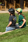 Teen girls, wearing riding helmets, converse at summer camp,  Cheley Camp, Estes Park, Colorado, USA, Rocky Mountians, not released
