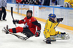 Pyeongchang, Korea, 10/3/2018-Adam Dixon of Canada plays Sweden in hockey during the 2018 Paralympic Games in PyeongChang. Photo Scott Grant/Canadian Paralympic Committee.