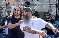NWA Democrat-Gazette/BEN GOFF @NWABENGOFF<br /> Scotty 'Memphis' Robertson (left) and friend Matt Gillen, both of Steele, Mo. encourage fans to vote for their bike with their cheers on Saturday Sept. 26, 2015 during the Stokes Air Battle of the Bikes at the annual Bikes, Blues & BBQ motorcycle rally in downtown Fayetteville. Robertson was crowned champion of the show for the thirds straight year, and says he plans to quit his job to build motorcycles full time with his business Robertson Brothers Speed Shop.