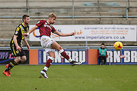 Lee Martin of Northampton Town (right) shoots during the Sky Bet League 2 match between Northampton Town and Morecambe at Sixfields Stadium, Northampton, England on 23 January 2016. Photo by David Horn / PRiME Media Images.