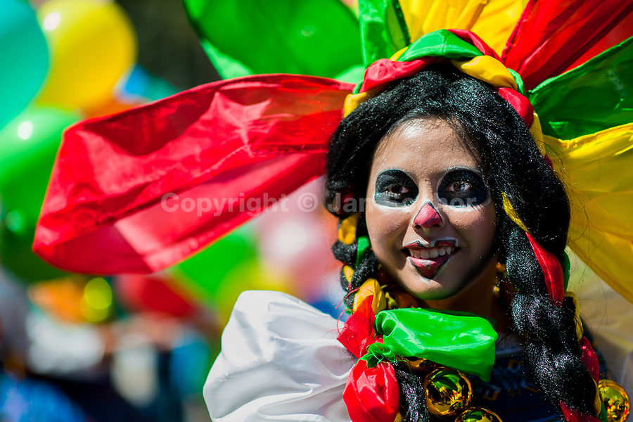 A Mexican girl, wearing a colorful costume and having her face painted, takes part in the Day of the Dead parade in Mexico City, Mexico, 29 October 2016. Day of the Dead (Día de Muertos), a syncretic religious holiday combining the death veneration rituals of the ancient Aztec culture with the Catholic practice, is celebrated throughout all Mexico. Based on the belief that the souls of the departed may come back to this world on that day, people gather at the gravesites in cemeteries praying, drinking and playing music, to joyfully remember friends or family members who have died and to support their souls on the spiritual journey.