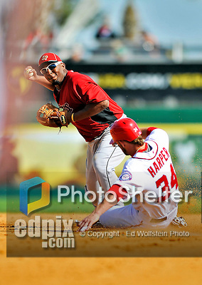 4 March 2012: Houston Astros' infielder Joe Thurston gets Bryce Harper out at second on a double play ball against the Washington Nationals at Space Coast Stadium in Viera, Florida. The Astros defeated the Nationals 10-2 in Grapefruit League action. Mandatory Credit: Ed Wolfstein Photo