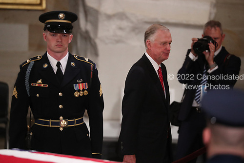 Former U.S. Vice President Dan Quayle walks past the casket of former President George H.W. Bush as it lies in state in the U.S. Capitol Rotunda in Washington, U.S., December 3, 2018. REUTERS/Jonathan Ernst/Pool