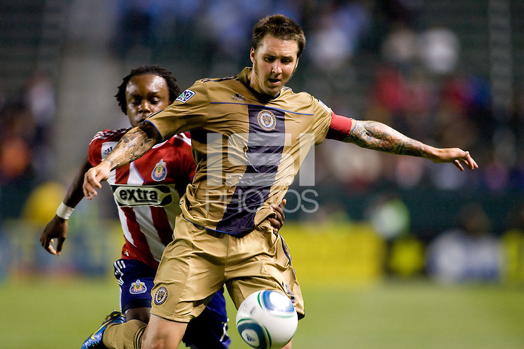Philadelphia Union defender and Captain Danny Califf (4) moves to clear a ball. The Philadelphia Union and CD Chivas USA played to 1-1 draw at Home Depot Center stadium in Carson, California on Saturday evening July 3, 2010..