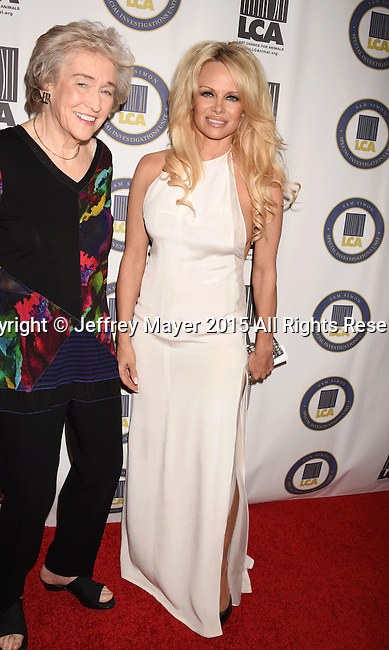 BEVERLY HILLS, CA - OCTOBER 24: Actress Pamela Anderson (R) and author Martha Grimes attend the Last Chance for Animals Benefit Gala at The Beverly Hilton Hotel on October 24, 2015 in Beverly Hills, California.