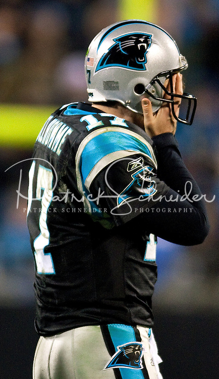 Carolina Panthers quarterback Jake Delhomme (17) covers his face against the Arizona Cardinals during the NFC Divisional Playoff football game at Bank of America Stadium, in Charlotte, NC. Arizona defeated the Carolina Panthers 33-13.