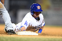Chattanooga Lookouts second baseman Ryan Adams (18) dives back to first during a game against the Birmingham Barons on April 24, 2014 at AT&T Field in Chattanooga, Tennessee.  Chattanooga defeated Birmingham 5-4.  (Mike Janes/Four Seam Images)