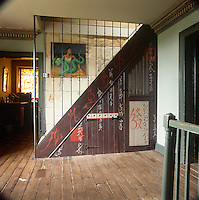 Albion House near Bath, the home of decorative painter Adam Calkin. an entrance hall with a wooden floor and a paint finish on the staircase