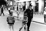 Policeman moved boy on by the scruff of the neck at the end of a Bay City Rollers concert Hammersmith Odeon London 1975