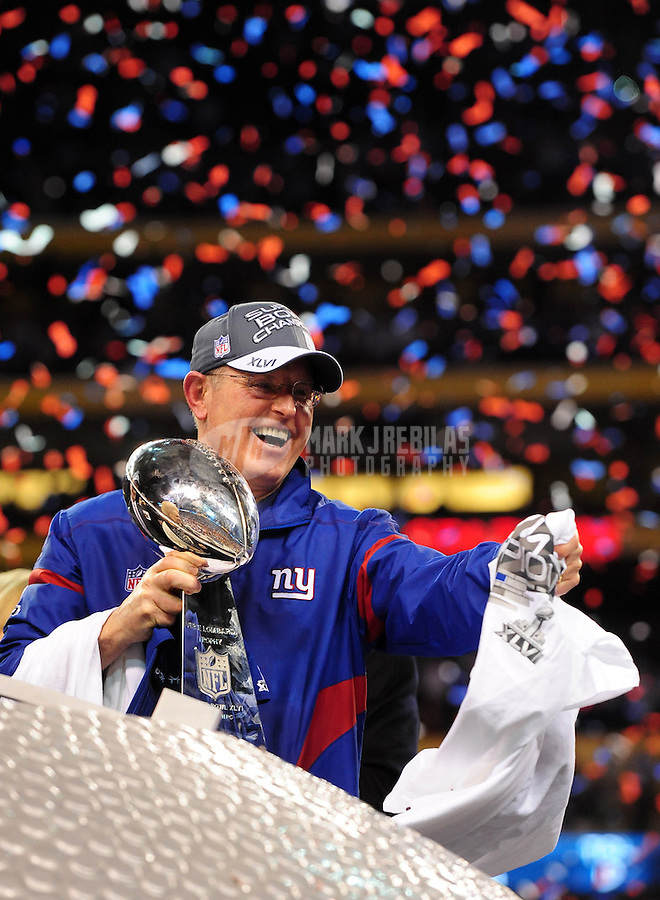 Feb 5, 2012; Indianapolis, IN, USA; New York Giants head coach Tom Coughlin holds the Vince Lombardi trophy after the Giants defeated the New England Patriots 21-17 in Super Bowl XLVI at Lucas Oil Stadium.  Mandatory Credit: Mark J. Rebilas-..