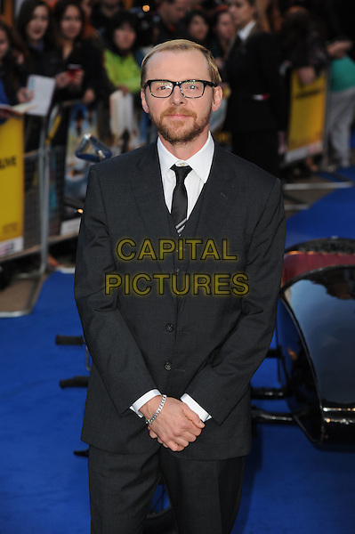 Simon Pegg.'The Adventures of Tintin: The Secret of the Unicorn' UK film premiere, 55th BFI London Film Festival, Odeon West End cinema, Leicester Square, London, England..23rd October 2011.LFF half length black suit glasses beard facial hair glasses .CAP/CAS.©Bob Cass/Capital Pictures.