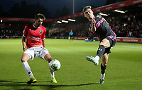 Leeds United's Leif Davis crosses under pressure from Salford City's Joey Jones<br /> <br /> Photographer Alex Dodd/CameraSport<br /> <br /> The Carabao Cup First Round - Salford City v Leeds United - Tuesday 13th August 2019 - Moor Lane - Salford<br />  <br /> World Copyright © 2019 CameraSport. All rights reserved. 43 Linden Ave. Countesthorpe. Leicester. England. LE8 5PG - Tel: +44 (0) 116 277 4147 - admin@camerasport.com - www.camerasport.com