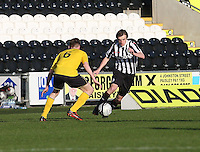 Kieran Doran takes on Ryan Blair in the St Mirren v Falkirk Clydesdale Bank Scottish Premier League Under 20 match played at St Mirren Park, Paisley on 30.4.13.