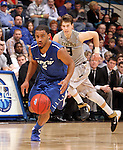 SIOUX FALLS, SD - MARCH 10:  Pierre Bland #2 from IPFW gets control of the ball in front of Travis Bader #3 from Oakland in the second half of their quarterfinal game Sunday night at the 2013 Summit League Basketball Tournament in Sioux Falls, SD.  (Photo by Dave Eggen/Inertia)