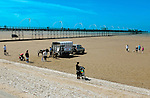 Southport.Merseyside.England. Beach scene with donkeys and Pier in background