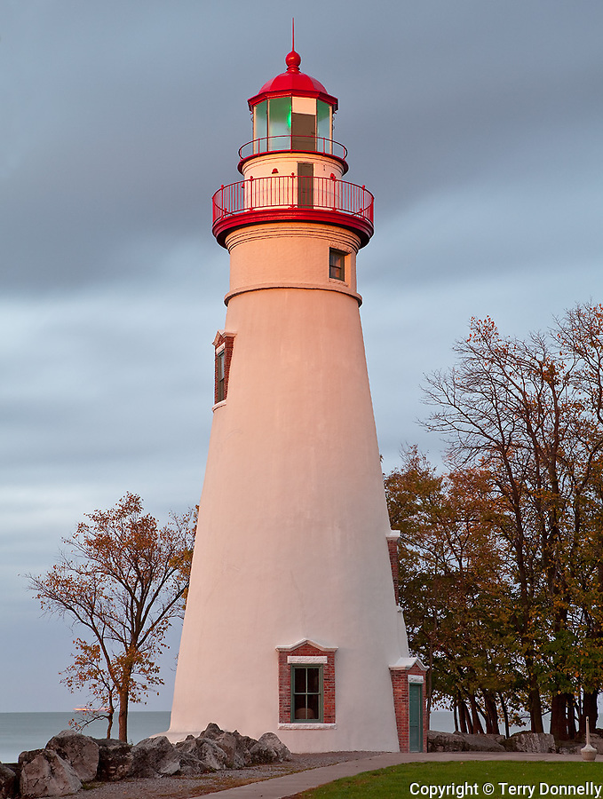 Marblehead Lighthouse State Park, OH<br /> Last light of setting sun on Marblehead Lighthouse (1819) on Lake Erie, oldest lighthouse in continuous operatoin on the great lakes