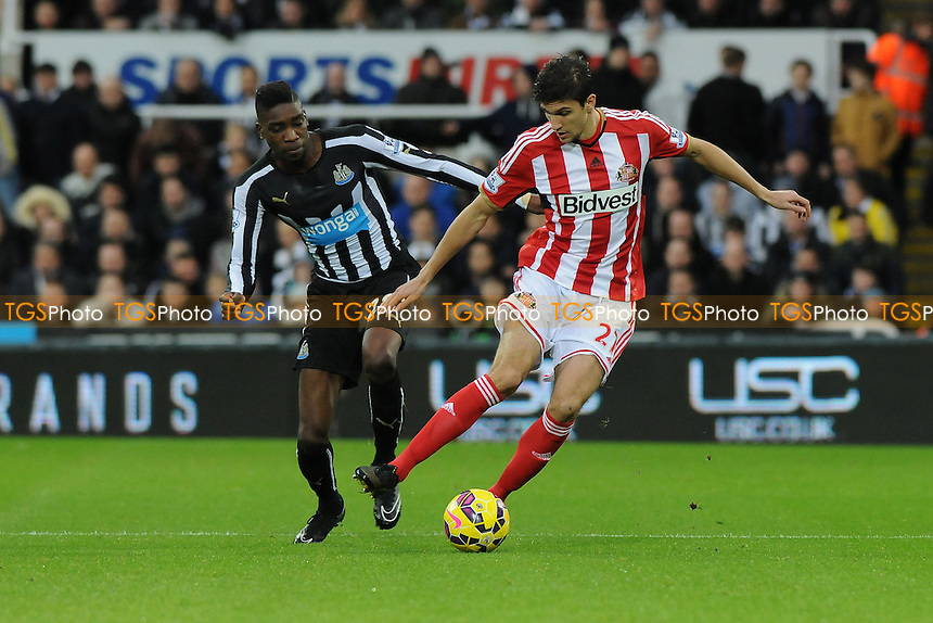 Santiago Vergini of Sunderland battles with Sammy Ameobi of Newcastle United - Newcastle United vs Sunderland AFC - Barclays Premier League Football at St James Park, Newcastle upon Tyne - 21/12/14 - MANDATORY CREDIT: Steven White/TGSPHOTO - Self billing applies where appropriate - contact@tgsphoto.co.uk - NO UNPAID USE