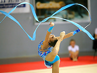 Evgeniya Kanaeva of Russia  waves with ribbon on way to winning senior All-Around at 2006 Trofeo Cariprato in Prato, Italy on June 17, 2006.  (Photo by Tom Theobald)
