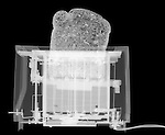 X-ray image of a toaster with bread (white on black) by Jim Wehtje, specialist in x-ray art and design images.