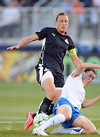 Washington Freedom forward Abby Wambach (20) struggles with Boston Breakers defender Amy LePeilbet .  Boston Breakers defeated Washington Freedom 3-1  at The Maryland SoccerPlex, Saturday April 18, 2009
