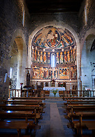 Central aisle looking towards the Byzantine Romanesque style Christian frescoes above the altar, Santissima Trinita di Saccargia, consecrated 1116 AD, Codrongianos, Sardinia.
