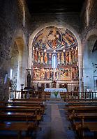 Central aisle looking towards the Byzantine Romanesque style Christian frescoes above the altar, Santissima Trinita di Saccargia, consecrated 1116 AD, Codrongianos, Sardinia.