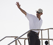 Honolulu, HI - January 1, 2009 -- United States President-elect Barack Obama waves farewell as he boards his chartered flight for Chicago Thursday, January 1, 2009 at Honolulu International Airport in Honolulu, Hawaii. Obama and his family arrived in his native Hawaii December 20 with his family for a low-key twelve day vacation..Credit: Kent Nishimura - Pool via CNP